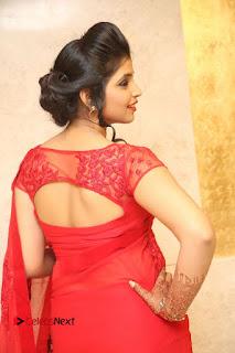 Actress Shyamala Stills in Red Saree at Okkadochadu Movie Audio Launch  0389