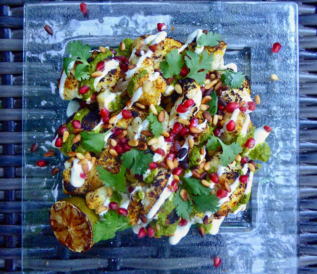 Middle-Eastern charred cauliflower with chimichurri, greek yogurt, pomegranate seeds and pine nuts