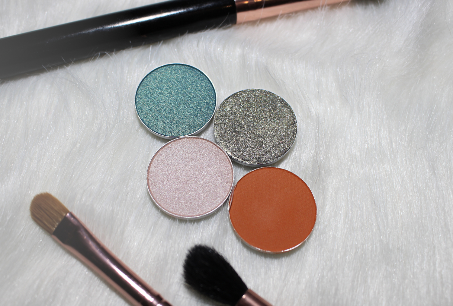 four single eyeshadows by mac cosmetics on the fur