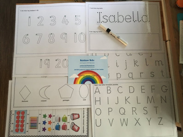 several white sheets of laminated cards which letters and shapes on copyright RainbowRobsVisuals on Etsy
