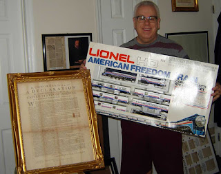 Frank DeFreitas holding a vintage Lionel HO scale American Freedom Train set from 1976, brand new and still sealed in the box.
