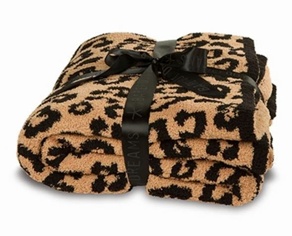 ... Dreams today in Miami! The reality star looked ready for a day of cozy  traveling as she headed to the airport with her Barefoot In the Wild Leopard  ... e71e7b8dd