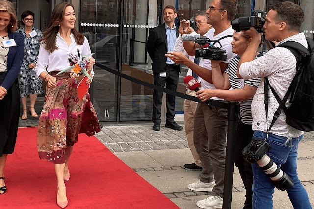 Crown Princess Mary wore a pleated printed silk crepe-de-chine midi skirt and white silk shirt from Valentino