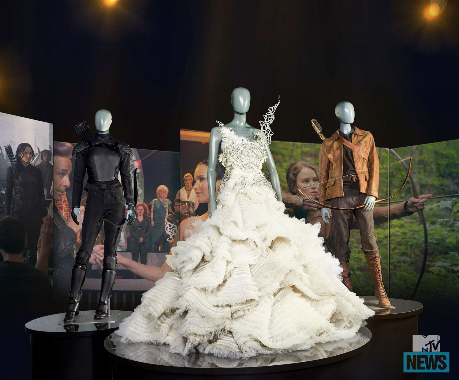 ... image from the u0027Katnissu0027s Journeyu0027 area which features the 3 iconic outfits worn by Katniss - the hunting outfit the wedding dress from Catching Fire ...  sc 1 st  Quarter Quell & New Image from u0027Katnissu0027s Journeyu0027 At The Hunger Games Exhibition ...