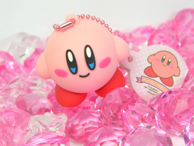 A Nintendo Kirby figural keychain and plastic pink gems