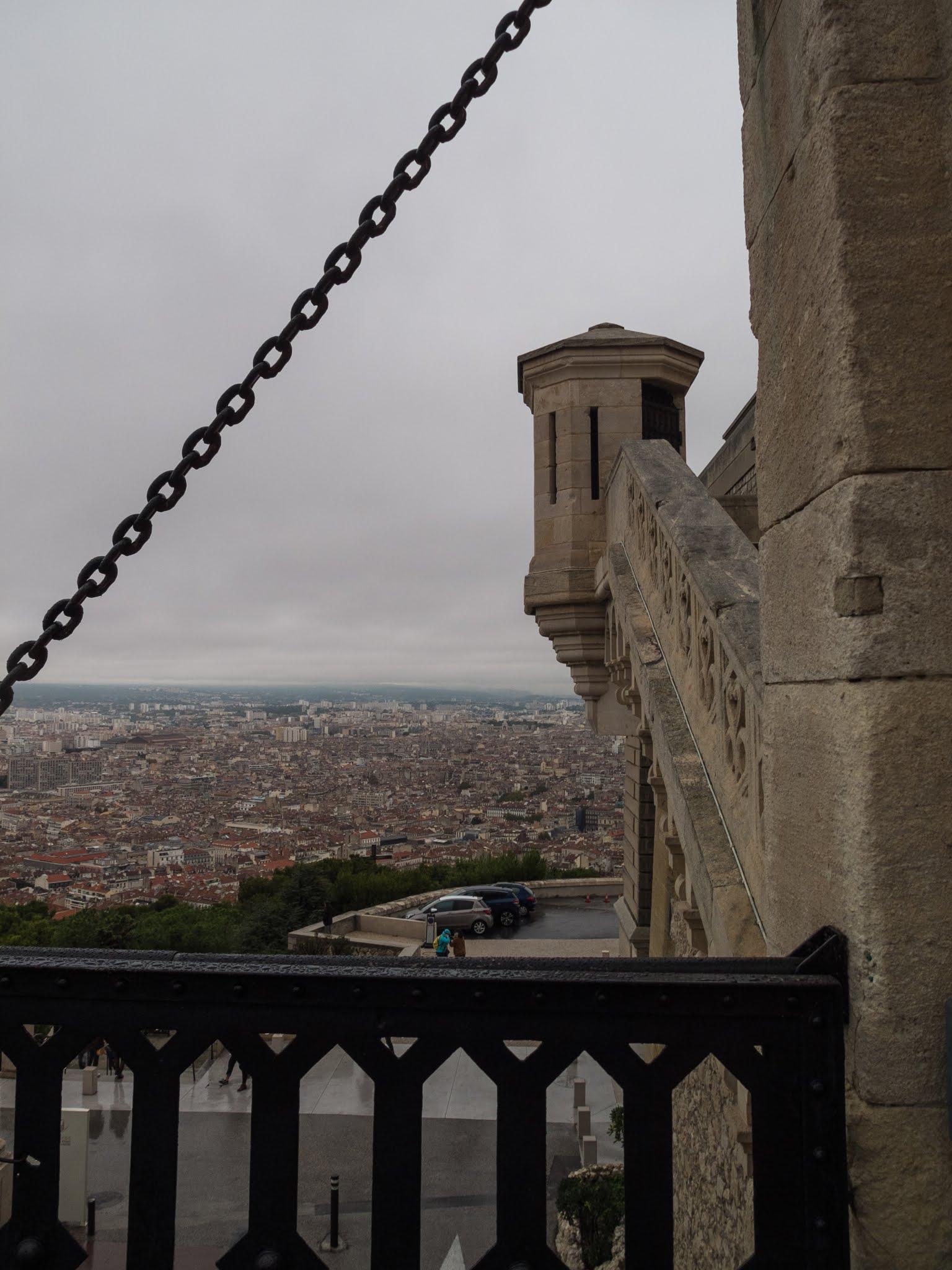 On the drawbridge of the Basilica of Notre Dame de la Garde looking towards Marseille.