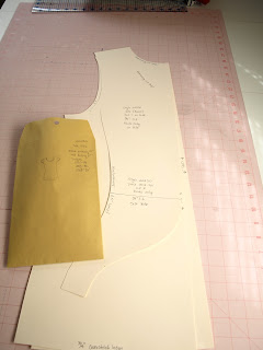 T-shirt pattern cut out of tag board