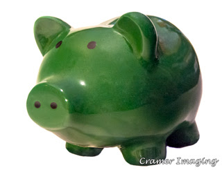 Green piggy bank on white background photograph by Cramer Imaging