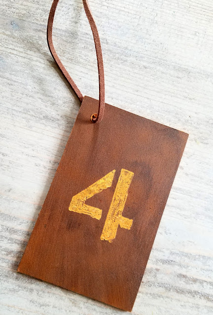 number four engraved on a piece of leather with a Dremel 4300 tool