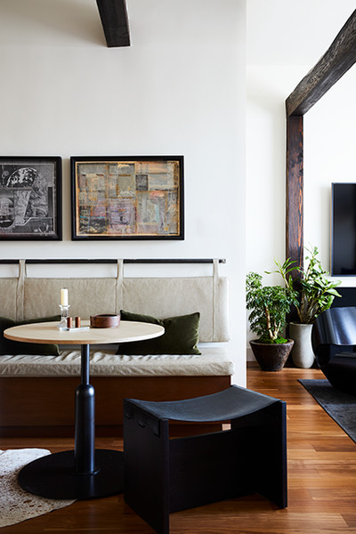 banquette bench with pad hung on wall and round breakfast table