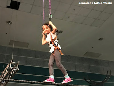 Child walking on a tight rope