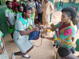 HON. ADIJAT FETES PUPILS, TRADERS WITH EDUCATIONAL ITEMS, CASH