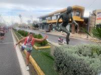 Posing like a runner; Athens Authentic Marathon in Greece. Wearing IllumiNITE Vigor Singlet; Shortie