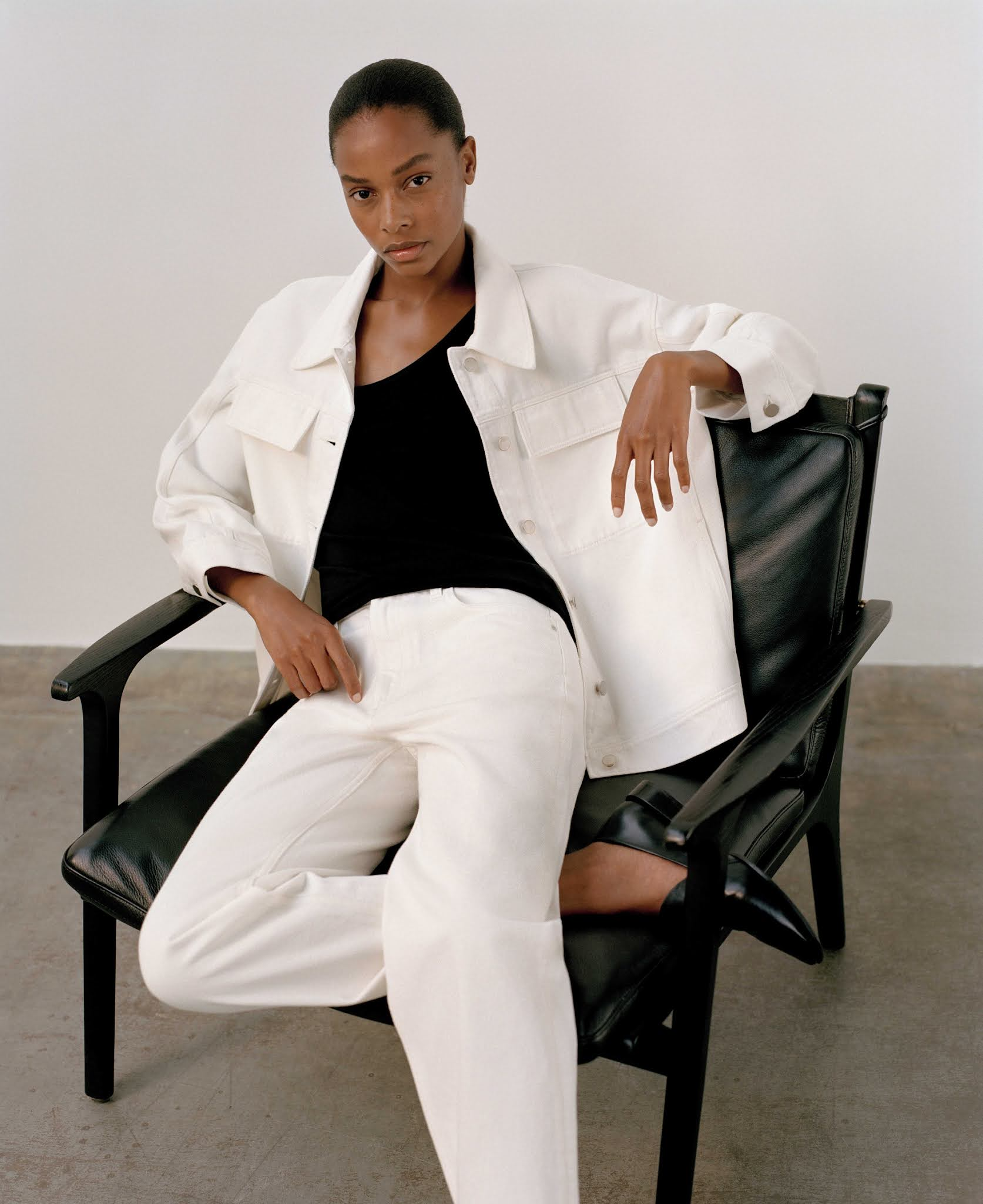 5 Minimalist Fall Outfit Ideas — Capsule Wardrobe with with a white denim jacket, black top and white jeans