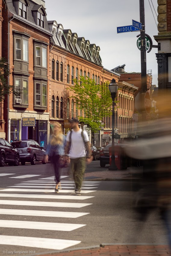 September 2018 photo by Corey Templeton. Portland, Maine USA. People in motion at Middle & Exchange Streets.