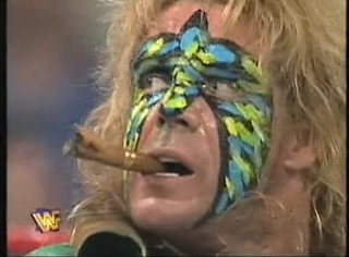 WWF / WWE - IN YOUR HOUSE 7 - GOOD FRIENDS BETTER ENEMIES - Ultimate Warrior smokes Marlena's cigar in his 'match' against Goldust