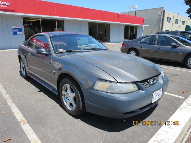 Faded Mustang with peeling paint & dents before repairs & paint at Almost Everything Auto Body