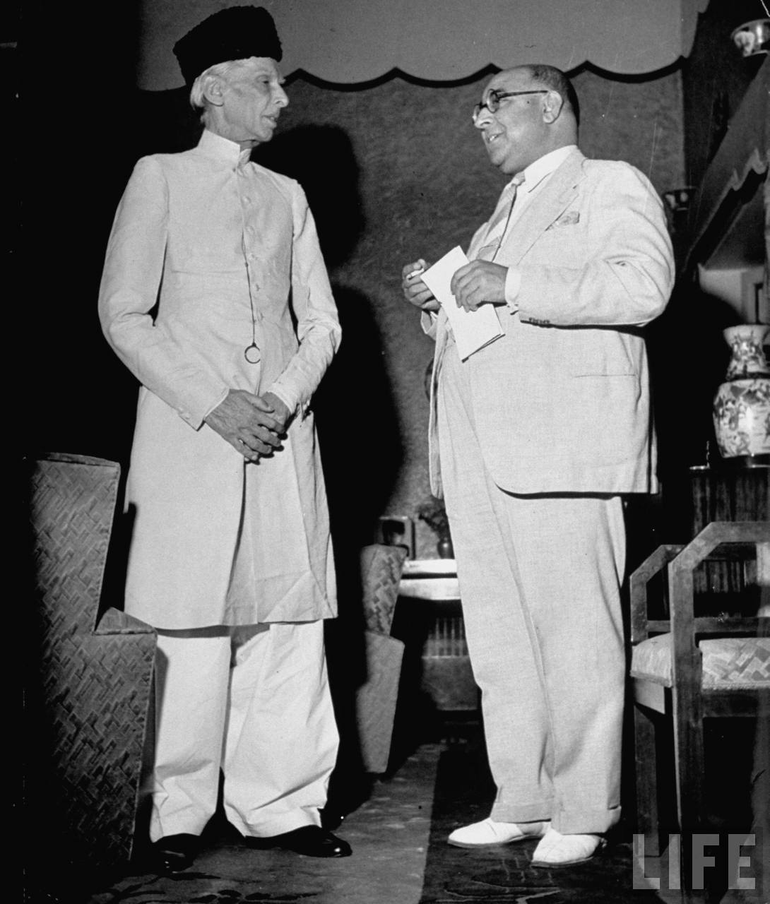 Mohammed Ali Jinnah, President of India's Moslem League in conversation with Nawazawa Liaquad Ali Khan at a political meeting - New Delhi May 1946