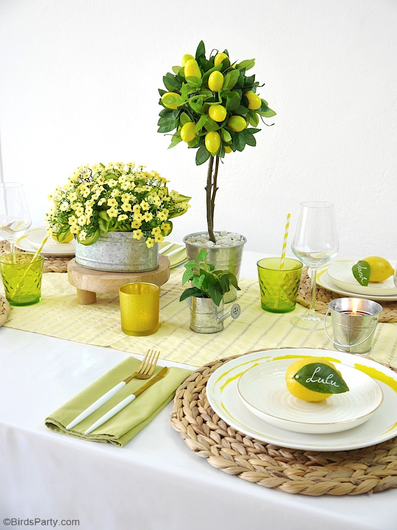 A Lemon Themed Tablescape for Summer - easy DIY crafts and ideas to style a pretty summer table! by BirdsParty.com @birdsparty #lemon #lemontable #tablescape #tabledecor #tablesetting #lemontablescape #summertable #lemontablescape #lemondecor #lemondiy