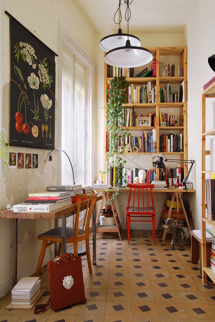 A beautiful studio with a variety of books and art