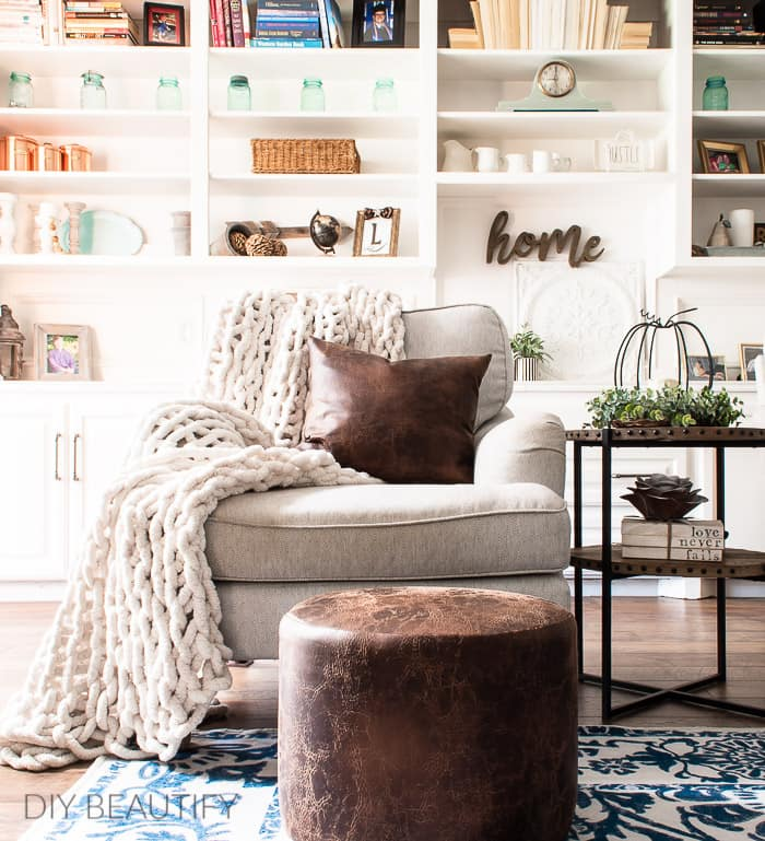 living room with brown leather ottoman