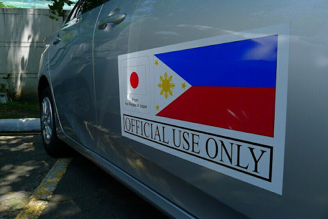 "The Japanese government, through its Non-Project Grant Aid, has funded the purchase of P250-Million worth of Toyota Prius Hybrid cars. They did this to support the Philippine Government, specifically the Department of Energy's campaign to promote energy efficiency and clean air across the country. The DOE will distribute the cars to replace some service vehicles of national government offices with hybrid cars. Officials of the Energy Utilization Management Bureau and Japan's Ambassador to the Philippines, Kazuhide Ishikawa, turned over the hybrid Toyotas to the beneficiaries last Friday at the DOE Sunken Garden in Taguig.  The Non-Project Grant Aid (NPGA) is part of the Japan International Cooperation System. A hybrid car is called such because it is powered two different ways. It has an optimized fuel engine while also having an electric motor to provide another means of moving the vehicle. Using a computer, the car can move by either mechanism or both at the same time, depending on the driving conditions. The electric motor is usually for slow speed. The fuel engine comes in when more power is needed. Also, when the car is on a downhill road, or when the car is cruising, the batteries are actually being charged by the electric motor. This increases the efficiency of the car. In uphill climbs, the motor assists the fuel engine so that less fuel is also used. This is how hybrid vehicles attain the highest energy efficiency. The best part is that hybrid cars have lower carbon emission, making it more environmentally friendly. The beneficiaries of the hybrid cars include the Office of the President, Department of the Interior and Local Government (DILG), Department of Finance (DOF), Department of Foreign Affairs (DFA), Department of Budget and Management (DBM), Department of Transportation, Department of Tourism (DOT), Department of Trade and Industries (DTI), Department of Environment and Natural Resources (DENR), National Economic Development Authority, Department of Science and Technology (DOST) and the Philippine National Police. Eight hybrid cars will also be given to government offices in Region 8, including the DENR, DTI, DOST, Bureau of Fire Protection, Philippine Information Agency, Land Transportation Office and the Regional Disaster Risk Reduction and Management Council. They were given priority to support the recovery of the local government and the many communities devastated by Super Typhoon Yolanda in 2013. ""This Japan government-aided grant will jump-start our drive towards our call to action to our fellow public servants to increase their use or patronize energy efficient technologies, including their official vehicles. We have to be the role model in this cause, so our people can look up to us and follow our lead,"" Energy Secretary Alfonso Cusi said. In the Philippines, a compact version of Prius is available, the Prius C. Toyota Philippines website quotes the price of the standard model at P1,639,000. The full options sells for P1,689,000."