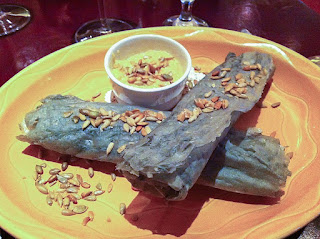Piki, traditional Hopi Blue Corn cakes, rolled up and served at a modern restaurant in Arizona. (Image Source)