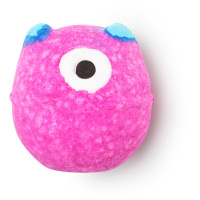 A spherical pink bath bomb with a white circular spot with a black circular chocolate dot in the middle for an eye with rectangular red horns on the top on a bright background