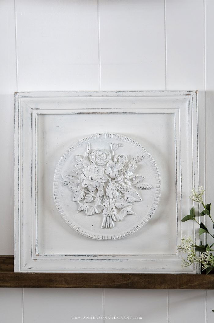 White floral medallion in frame