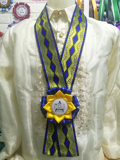 Blue and Yellow Rosette Lei for Events in a Barong Tagalog Attire in the Philippines