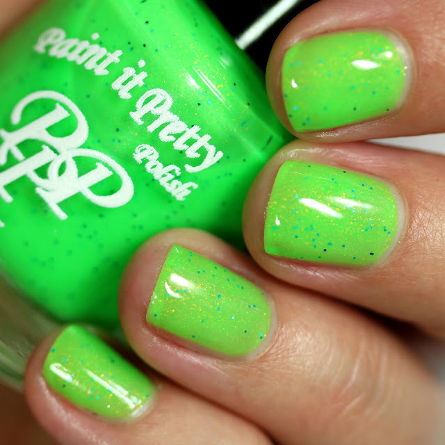 neon green nail polish with tiny blue glitters and sparkle