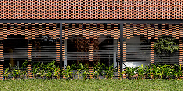 brick and metal combined to create a geometric modern wall
