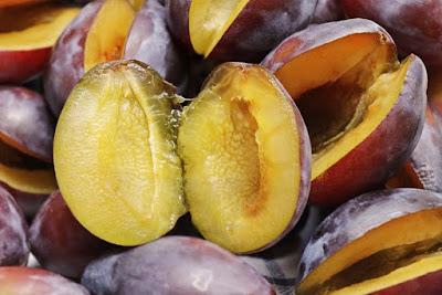 Plum-Nutrition-Facts-100g-halved-plum-picture