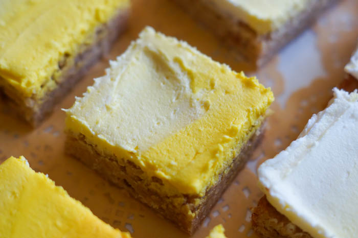 Frosted Lemon Cookie Bars with a sunshine-y ombre yellow frosting.