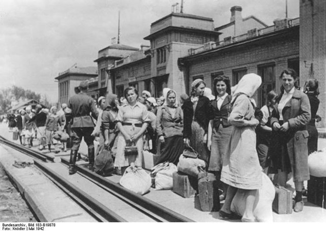 Ukrainian laborers waiting to go to Germany, May 1942 worldwartwo.filminspector.com