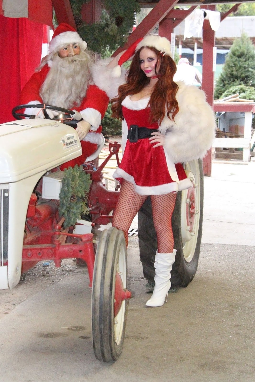 Phoebe Price gets in the Holiday spirit as she dresses up like Santa at a Christmas Tree farm 12/14/2018