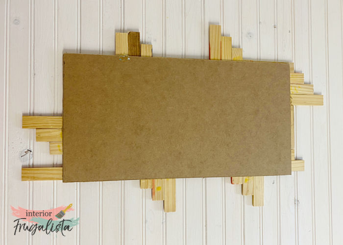 An easy beginner recycled wood tile geometric mosaic fall wall art with a simple pattern that doesn't require intricate cuts, stained in fall colors.