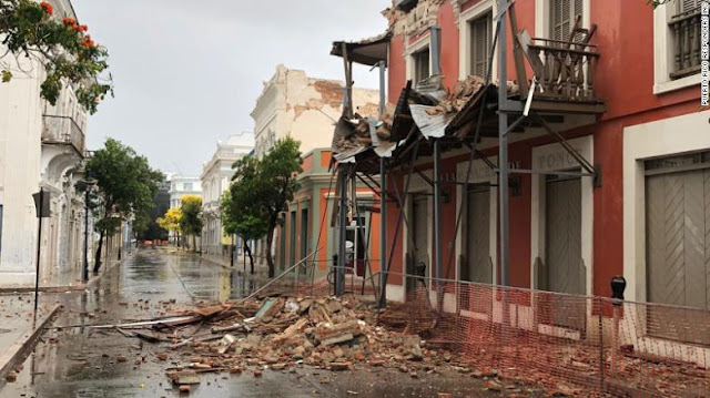 Rubble litters a street in Puerto Rico after Saturday's temblor.