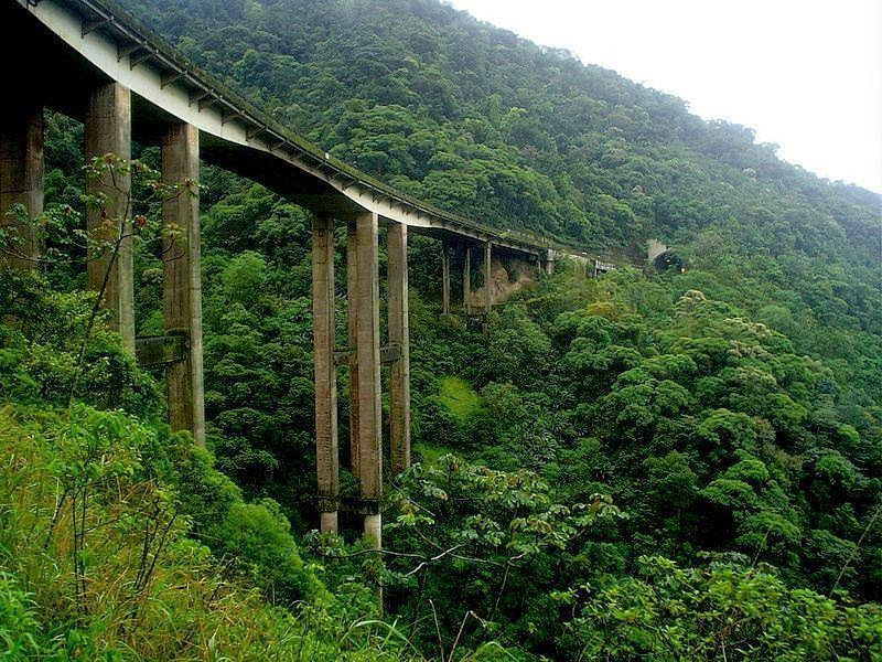 "Rodovia dos Imigrantes, officially known as ""SP-160"" — The road over the trees is a highway in the state of São Paulo, Brazil."