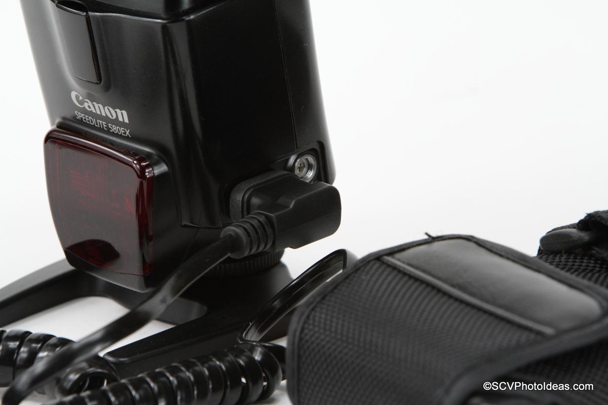 Canon Speedlite 580EX with external battery pack closeup