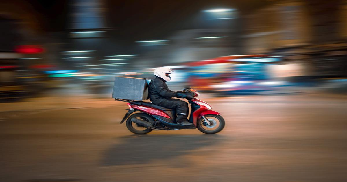 a food delivery boy on his scooter going for food delivery