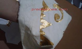 prada emas pada kain