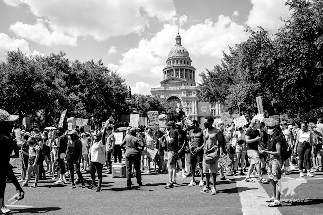 Thousands of people gather in front of the Texas State Capitol.