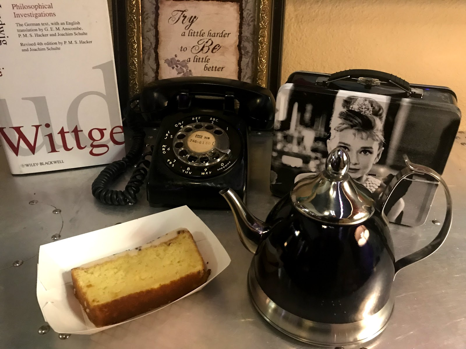 Image: Tea pot, cake and pictures at a vintage coffee house in Bossier City Louisiana.Visits and pictures taken by Tangie Bell. seen First on Bits and Babbles blog