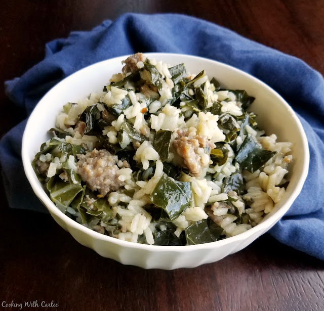 close up of serving of collards, sausage and rice in bowl