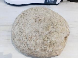 Risen dough on an oiled work surface.