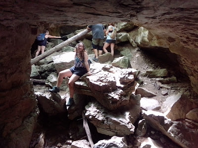 Girl posing at cave entrance