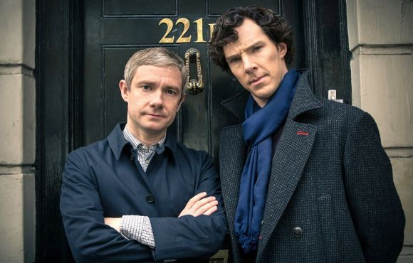 Martin Freeman and Benedict Cumberbatch in front of 221B Baker Street