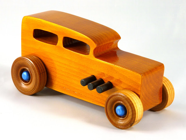 Right Front - Wooden Toy Car - Hot Rod Freaky Ford - 32 Sedan - Pine - Amber Shellac - Black Pipes - Metallic Blue Hubs