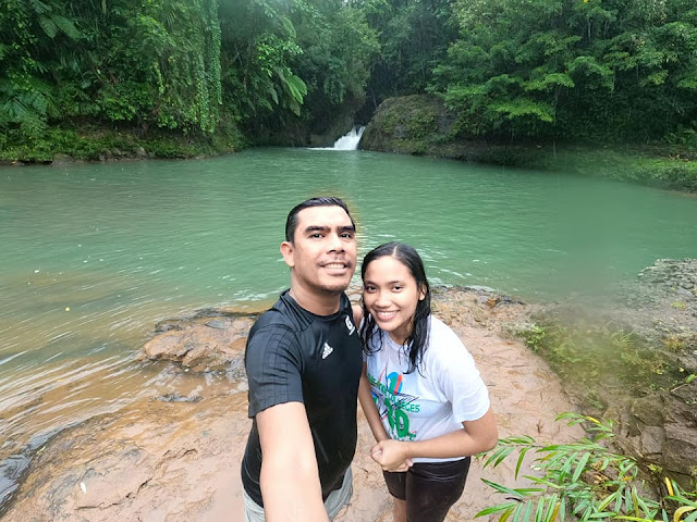 couple enjoying waterfalls at Nakatagong Paraiso Real Quezon